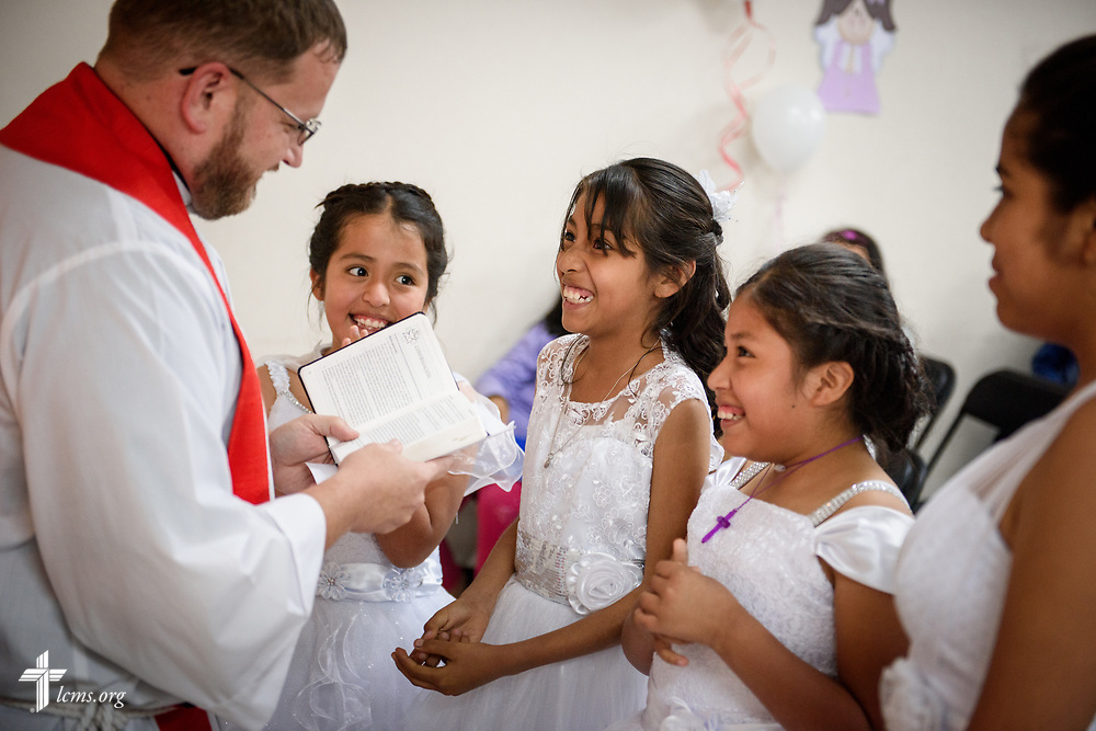 The Rev. Eddie Hosch, LCMS career missionary to Peru, confirms joyful new members at Castillo Fuerte on Saturday, Nov. 4, 2017, in the La Victoria district of Lima, Peru. LCMS Communications/Erik M. Lunsford