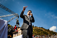 An announcer holds aloft a small Naga chili, or King Chili: the hottest chili in the world. One of the main attractions at the Hornbill Festival in Nagaland, India, is the Naga Chili Eating Contest. Here, the announcer describes to the crowd the brutality of the small beast.