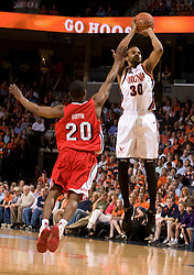 Virginia forward Adrian Joseph (30) shoots a three pointer over Bradley guard Daniel Ruffin (20).  The Virginia Cavaliers fell to the Bradley Braves 96-85 in the semifinals of the 2008 College Basketball Invitational at the University of Virginia's John Paul Jones Arena in Charlottesville, VA on March 26, 2008.
