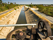 01 MARCH 2016 - CHACHOENGSAO, THAILAND: The controls of a water gate at a nearly empty irrigation canal in Chachoengsao province of Thailand. Thai government officials have warned that there may not be enough water in the country's reservoirs to provide adequate water for farming, including fish and shrimp farms, industrial needs and domestic consumption. The government has told rice and fish farmers to reduce their use of water, and if necessary to reduce their crops. The current El Niño weather pattern is being blamed for the drought. The 2015 rainy season was well below normal and the 2016 rainy season could start two months late.    PHOTO BY JACK KURTZ