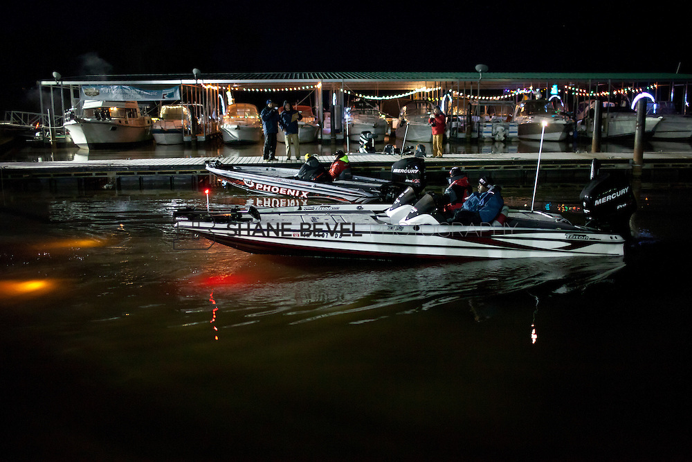 2/25/12 7:01:04 AM -- during the 2012 Bassmaster Classic on the Red River in Shreveport, La. ..Photo by Shane Bevel.Boats launch on the Red River. .Boats launch on the Red River.