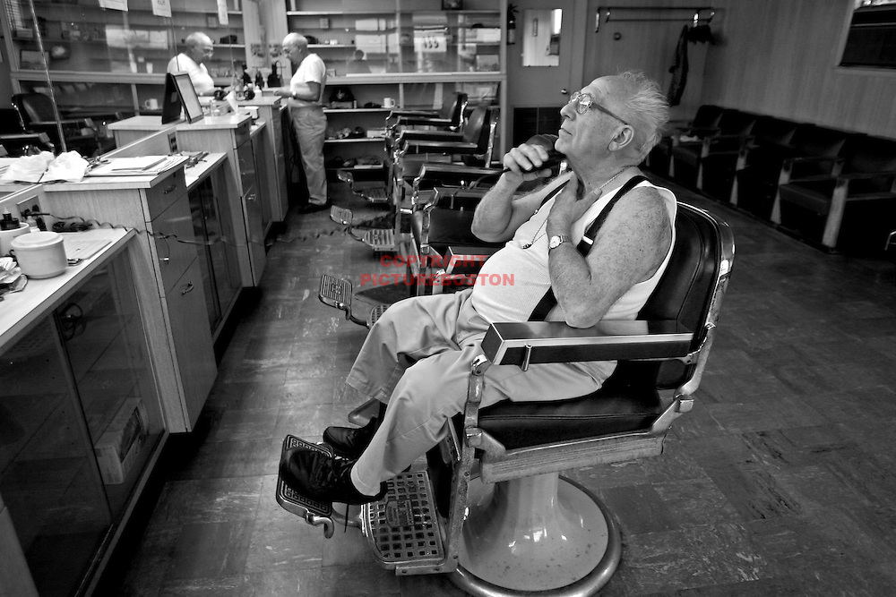 Tony takes his last shave in the chair that has been his home for over fifty years. Tommorrow, the chairs will be gone.