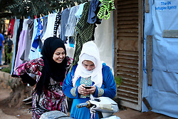 Syrian refugees in a settlement camp where they live amongst an olive grove in Koura, near Tripoli, Lebanon.