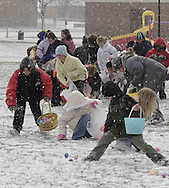 The scramble for the eggs, made more difficult by a brief snow shower as they got started at an Easter egg hunt sponsored by the Montgomery County Sheriff's Office Police Athletic League, Saturday morning..