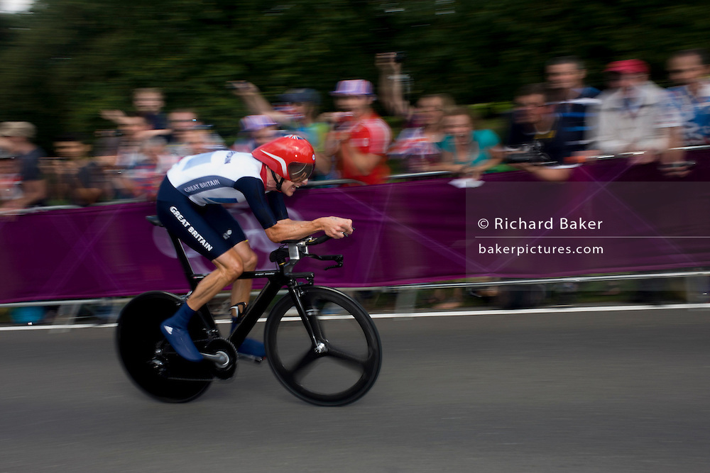 Team GB cyclist Bradley Wiggins races past fans lining the route through Bushy Park in south west London, during the London 2012 Olympic 44km men's cycling time trial, eventually won Wiggins, 42 seconds ahead of German Tony Martin.