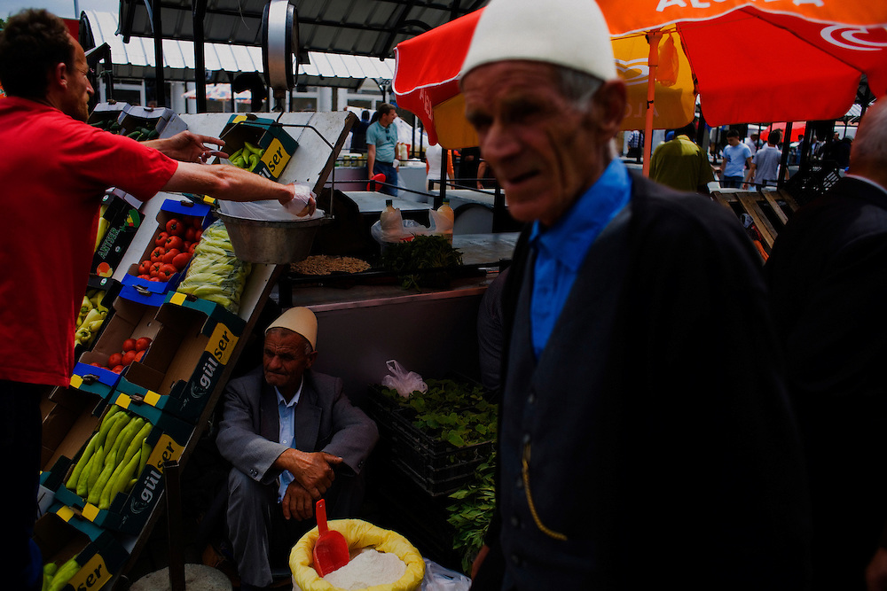 Fruit sellers at the Sunday market in Albanian Mitrovica, Kosovo.
