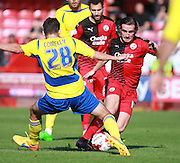 Crawley Town midfielder Luke Rooney and Accrington Stanley player Seamus Conneely compete for possession during the Sky Bet League 2 match between Crawley Town and Accrington Stanley at the Checkatrade.com Stadium, Crawley, England on 26 September 2015. Photo by Bennett Dean.