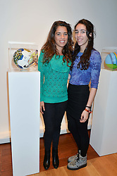 Left to right, JIMENA PARATCHA former wife of musician Jimmy Page and their daughter JANA PAGE at the Art of Futebol - a charity auction of 11 footballs signed by 11 Brazilian legends from Pele to Neymar & decorated and designed by 11 leading contemporary artists in aid of Action for Brazil's Children Trust held at the Brazilian Embassy, 16 Cockspur Street, London on 10th July 2014.