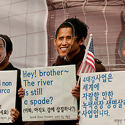 "Demonstrators wearing masks of G20 leaders hold signs protesting the controversial ""Four Rivers Project"" at a protest in Seoul, South Korea, during the G20 Summit. The Four Rivers Project is an initiative of the Lee Myung-bak administration to restore South Korea's four major rivers, and it has drawn criticism from environmentalists in South Korea."