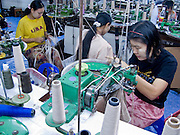 "25 FEBRUARY 2008 -- MAE SOT, TAK, THAILAND: Illegal Burmese workers in a sewing factory in Mae Sot, Thailand. The factory owner allegedly bribes Thai officials not to raid his place. Workers here work seven days a week, 14 hours per day and make about $5 US per day. Their housing, which is provided by the factory owner, is in the factory compound. There are millions of Burmese migrant workers and refugees living in Thailand. Many live in refugee camps along the Thai-Burma (Myanmar) border, but most live in Thailand as illegal immigrants. They don't have papers and can not live, work or travel in Thailand but they do so ""under the radar"" by either avoiding Thai officials or paying bribes to stay in the country. Most have fled political persecution in Burma but many are simply in search of a better life and greater economic opportunity.  Photo by Jack Kurtz"
