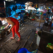 CAPTION: Thuy prepares soup to sell at her family's cafe. LOCATION: An Binh Ward, Can Tho, Vietnam. INDIVIDUAL(S) PHOTOGRAPHED: Phan Thi Thu Thuy.