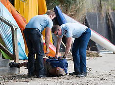 Auckland - Police arrest man on beach
