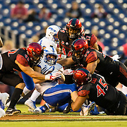 12 October 2018: The Aztecs defense makes a gang tackle in first quarter. The San Diego State Aztecs lead 14-9 at the half against the Air Force Falcons at SDCCU Stadium Friday night.