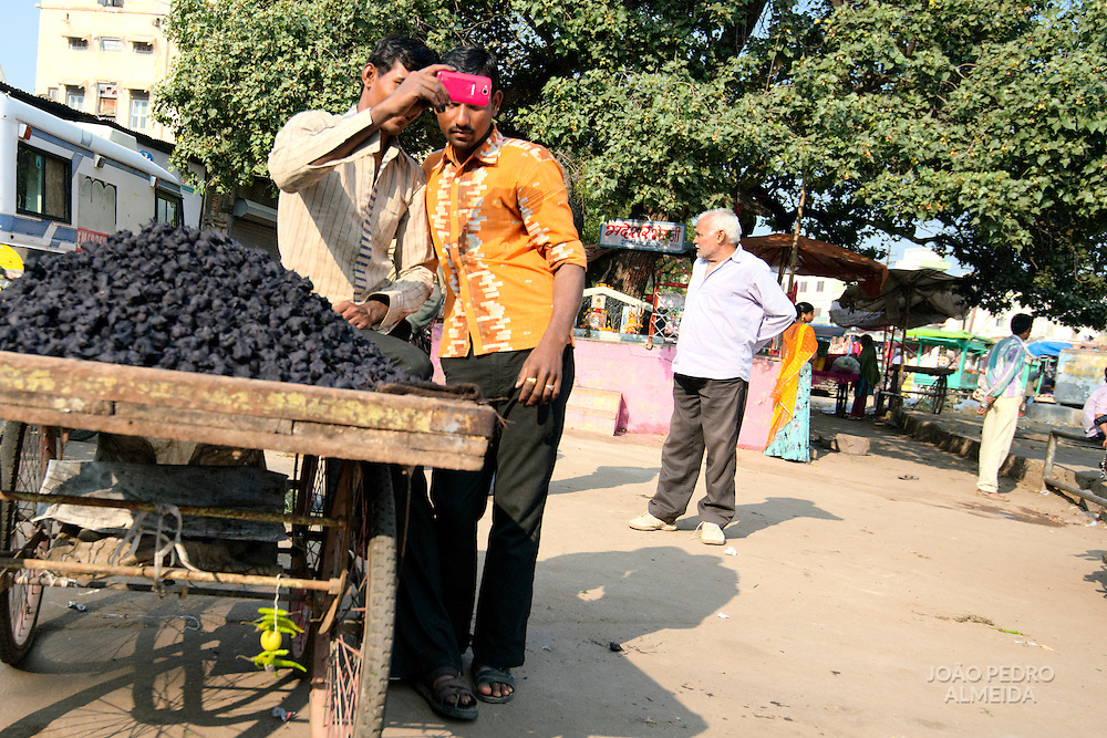 Men at Usipur street market taking a selfie