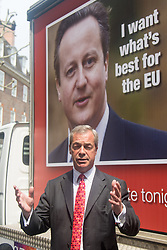 Smith Square, Westminster, London, June 7th 2016. UKIP Leader Nigel Farage launches a new campaign poster today outside Europe House ahead of a scheduled ITV Debate with the Prime Minister David Cameron. PICTURED: Cameron's face and committment to the EU looms over Nigel Farage.