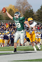 12 November 2011:  Cameron Blossom lifts the ball in celebration as he steps into the end zone during an NCAA division 3 football game between the Augustana Vikings and the Illinois Wesleyan Titans in Tucci Stadium on Wilder Field, Bloomington IL