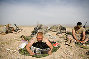 Private Joshua Hancock and the rest of the 82nd Airborne, 1/508 Parachute Infantry Regiment, Alpha Company, Third Platoon spend another day waiting on an isolated ridgetop for a new mission in Kandahar province, Afghanistan on Thursday, March 29, 2007.