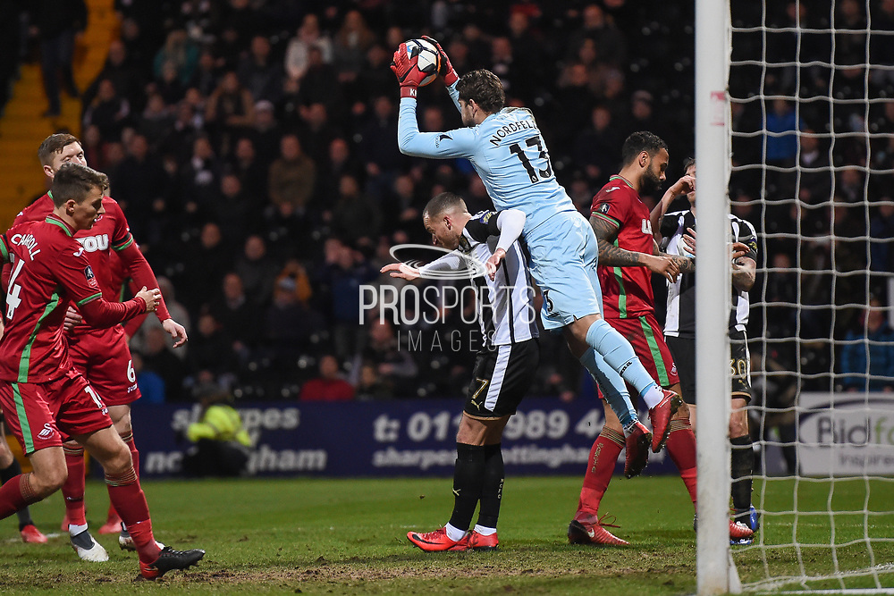 Notts County goalkeeper Adam Collin (1) jumps over Notts County forward Lewis Alessandra (7) and makes a save during the The FA Cup 4th round match between Notts County and Swansea City at Meadow Lane, Nottingham, England on 27 January 2018. Photo by Jon Hobley.