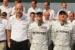 Motorsports / Formula 1: World Championship 2010, GP of Abu Dhabi,  Dr. Dieter Zetsche (Chairman of the Board of Management of Daimler AG, Head of Mercedes-Benz Cars), 03 Michael Schumacher (GER, Mercedes GP Petronas),   04 Nico Rosberg (GER, Mercedes GP Petronas),