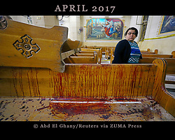 April 9, 2017 - Tanta, Egypt - A woman stands near a pew covered in blood inside a Coptic church that was bombed on Sunday. (Credit Image: © Mohamed Abd El Ghany/Reuters via ZUMA Press)