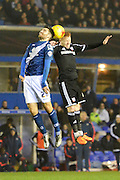 Birmingham City midfielder Jon Toral and Brentford midfielder Ryan Woods challenge for a header during the Sky Bet Championship match between Birmingham City and Brentford at St Andrews, Birmingham, England on 2 January 2016. Photo by Alan Franklin.