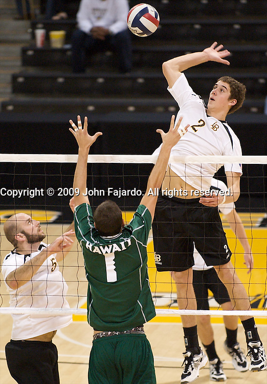Jim Baughman(2) gets the set from Mike Klipsch(5) with Matthew Rawson(1) defendingin the match against Hawaii at the Walter Pyramid, Long Beach CA, Thursday, February 12, 2009.  Long Beach State wins in three sets, 30-23, 31-29, 30-28.