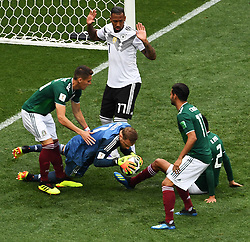 MOSCOW, June 17, 2018  Germany's goalkeeper Manuel Neuer (C) defends during a group F match between Germany and Mexico at the 2018 FIFA World Cup in Moscow, Russia, June 17, 2018. (Credit Image: © Wang Yuguo/Xinhua via ZUMA Wire)