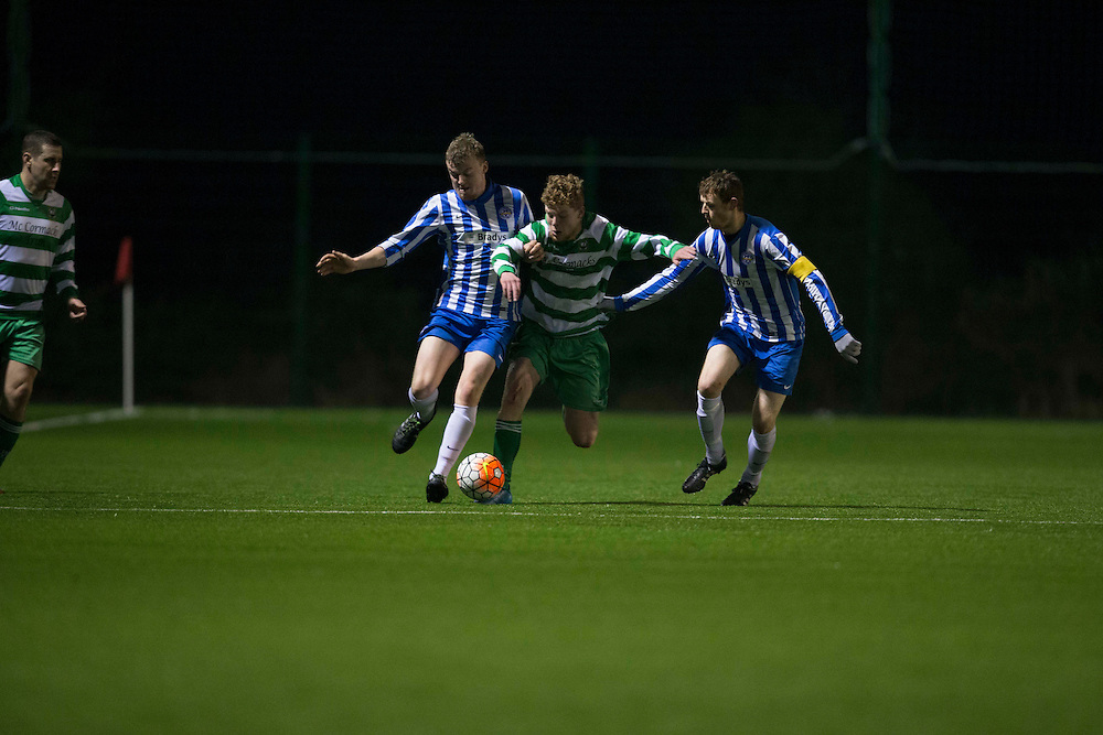 Kilmessan Shield Semi-Final at MDL, Navan, 26th February 2016.<br /> Navan Cosmos vs Trim Celtic<br /> Zak McGowan (Trim Celtic) & Donal Callan / Conor Walsh (Navan Cosmos)<br /> Photo: David Mullen /www.cyberimages.net / 2016