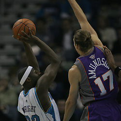 Feb 01, 2010; New Orleans, LA, USA; New Orleans Hornets forward Julian Wright (32) attempts a shot over Phoenix Suns center Louis Amundson (17)during the first half at the New Orleans Arena. Mandatory Credit: Derick E. Hingle-US PRESSWIRE