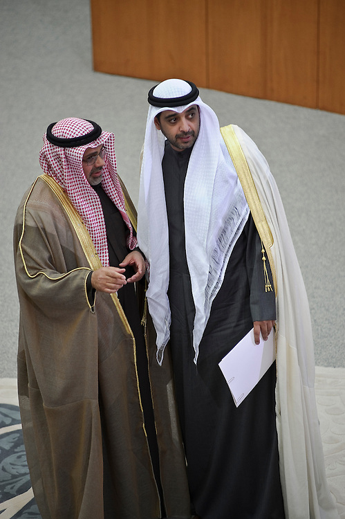 Information Minister Sheikh Mohammed Abdullah Mubarak Al-Sabah (Right of Picture) and Minister of Justice and Minister of Islamic Endowments and Affairs Jamal Al- Shihab (Left) stand in the National Assembly in Kuwait City Feb. 15, 2012, during the inauguration ceremony of the new parliamentary term. Kuwaitis voted Feb. 2 for a new 50- member legislature.