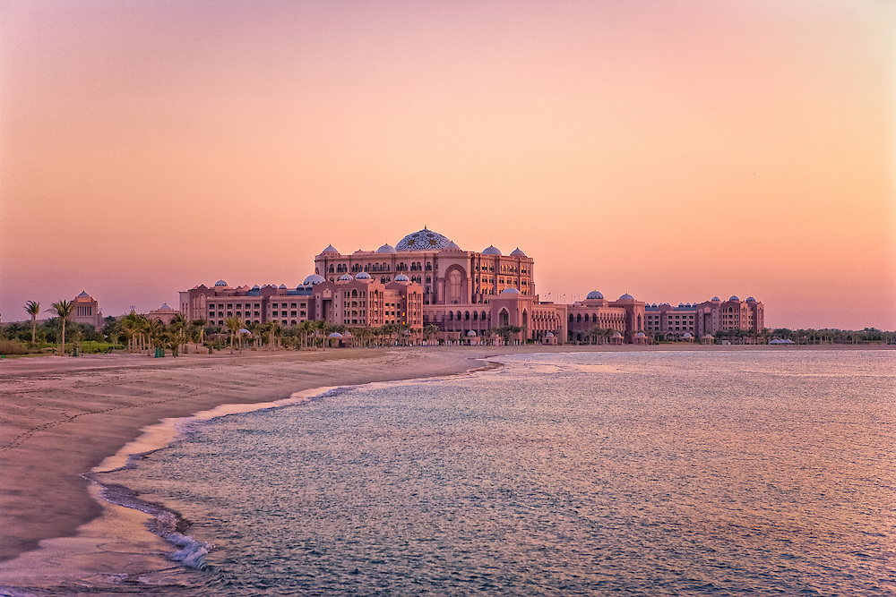 Beachside view of Emirates Palace hotel in the city of Abu Dhabi at Sunset taken in 2007 prior to the skyscrapers polluting its serene background