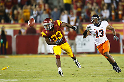 September 11, 2010; Los Angeles, CA, USA;  Southern California Trojans wide receiver Ronald Johnson (83) is unable to make a catch after being interfered on the pass by Virginia Cavaliers cornerback Chase Minnifield (13) during the third quarter at the Los Angeles Memorial Coliseum. USC defeated Virginia 17-14.