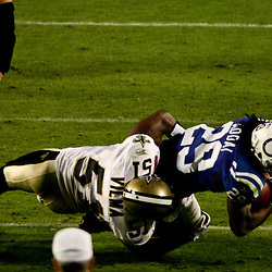 2010 February 07: New Orleans Saints linebacker Jonathan Vilma (51) tackles Indianapolis Colts running back Joseph Addai (29) during a 31-17 win by the New Orleans Saints over the Indianapolis Colts in Super Bowl XLIV at Sun Life Stadium in Miami, Florida.