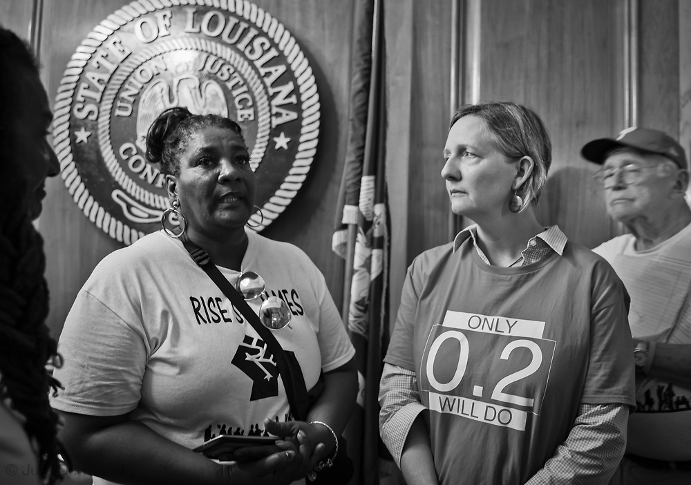 """Members of the Coalition Against Death Alley in the State Capitol  on the last day of a five day march through Louisiana's 'Cancer Alley' in  the reception area of the  Governor's office to deliver a letter. The Coalition Against Death Alley (CADA), is a group of Louisiana-based residents and members of various local and state organizations, is calling for a stop to the construction of new petrochemical plants and the passing of stricter regulations on existing industry in the area that include the groups RISE St. James, Justice and Beyond, the Louisiana Bucket Brigade, 350 New Orleans, and the Concerned Citizens of St. John.  Louisiana's Cancer Alley, an 80-mile stretch along the Mississippi River, is also known as the """"Petrochemical Corridor,"""" where there are over 100 petrochemical plants and refineries."""