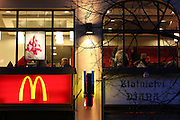 Mc Donalds branch located at the downer Wenceslas Square. Beside the Mc Donalds logo a commercial for a jewelery shop.