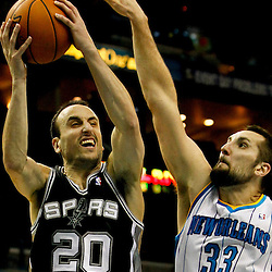 Jan 7, 2013; New Orleans, LA, USA; San Antonio Spurs shooting guard Manu Ginobili (20) shoots over New Orleans Hornets power forward Ryan Anderson (33) during the second quarter of a game at the New Orleans Arena. Mandatory Credit: Derick E. Hingle-USA TODAY Sports