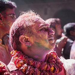 Coloured man during celebrations of Holi festival, Vrindavan, India