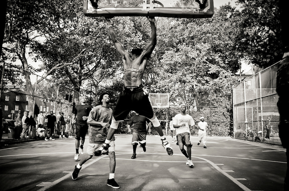 A basketball game on the playground located at the corner of  Avenue of the Americas and Minetta in the West Village, Manhattan, New york, 2010.