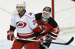 Apr 15, 2009; Newark, NJ, USA; New Jersey Devils goalie Martin Brodeur (30) looks around Carolina Hurricanes right wing Erik Cole (26) during the third period of game one of the eastern conference quarterfinals of the 2009 Stanley Cup playoffs at the Prudential Center. The Devils defeated the Hurricanes 4-1 to take a 1-0 series lead.