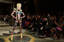 © Licensed to London News Pictures. 16/02/2018. LONDON, UK. A model presents a look by Pam Hogg at Fashion Scout AW18, part of London Fashion Week, taking place at Freemasons Hall in Covent Garden.  Watching from the front row are Lisa Snowdon and Yasmin Le Bon.  Photo credit: Stephen Chung/LNP