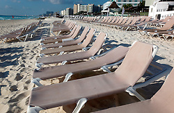 10 Feb 2014. Cancun, Mexico.<br /> Beach chairs on the tourist beach at Isla Cancun along the Zona Hotelera on the Carribean Sea. <br /> Photo; Charlie Varley/varleypix.com