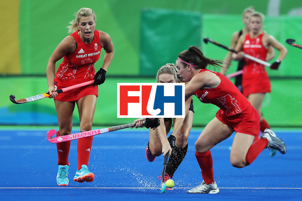 RIO DE JANEIRO, BRAZIL - AUGUST 17:  Sophie Cocks #17 of New Zealand and Laura Unsworth #4 of Great Britain in action during the Women's Semifinal match between New Zealand and Great Britain on Day 12 of the Rio 2016 Olympic Games at the Olympic Hockey Centre on August 17, 2016 in Rio de Janeiro, Brazil.  (Photo by Rob Carr/Getty Images)