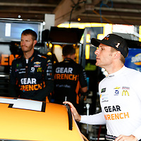 Jamie McMurray (1) hangs out in the garage during practice for the Gander Outdoors 400 at Dover International Speedway in Dover, Delaware.