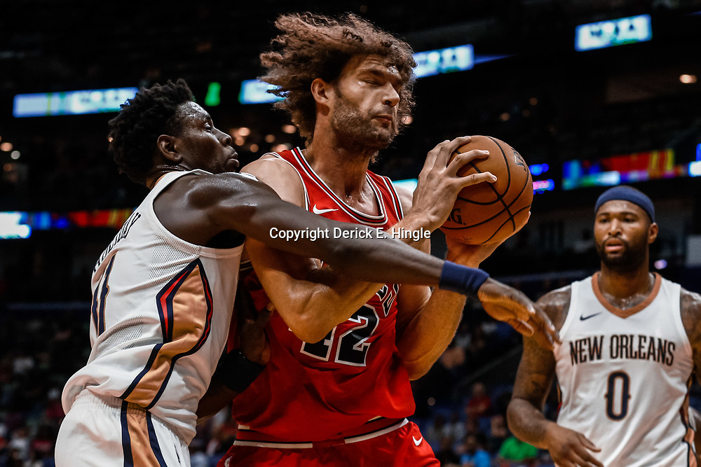 Oct 3, 2017; New Orleans, LA, USA; Chicago Bulls center Robin Lopez (42) is defended by New Orleans Pelicans guard Jrue Holiday (11) during the first quarter of a NBA preseason game at the Smoothie King Center. Mandatory Credit: Derick E. Hingle-USA TODAY Sports
