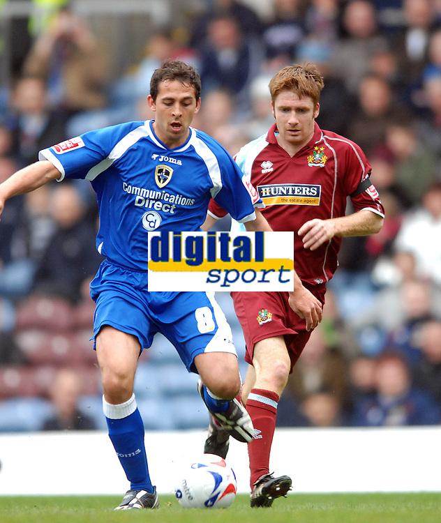 Photo: Paul Greenwood.<br />Burnley FC v Cardiff City. Coca Cola Championship. 09/04/2007.<br />Cardiff's Michael Chopra, (L) keeps the ball from Wade Elliott
