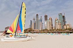 Jumeirah Beach resort district with high rise buildings to rear in Dubai, United Arab Emirates,UAE