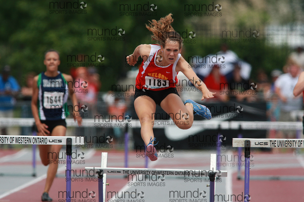 (London, Ontario}---05 June 2010) Ashley Taylor of Nelson - Burlington  competes in the 300m / 400m hurdle finals at the 2010 OFSAA Ontario High School Track and Field Championships in London, Ontario,  June 05, 2010. Photograph copyright Dave Chidley / Mundo Sport Images, 2010.