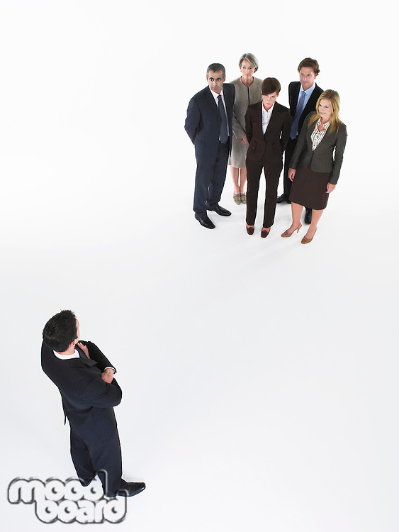 Businessman looking at group