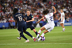 June 29, 2019 - Paris, ile de france, France - Christen Press (USA) dribble Griedge Mbock Bathy (FRA) and Elise Bussaglia (FRA) during the quarter-final between FRANCE vs USA in the 2019 women's football World cup at Parc des Princes in Paris, on the 28 June 2019. (Credit Image: © Julien Mattia/NurPhoto via ZUMA Press)