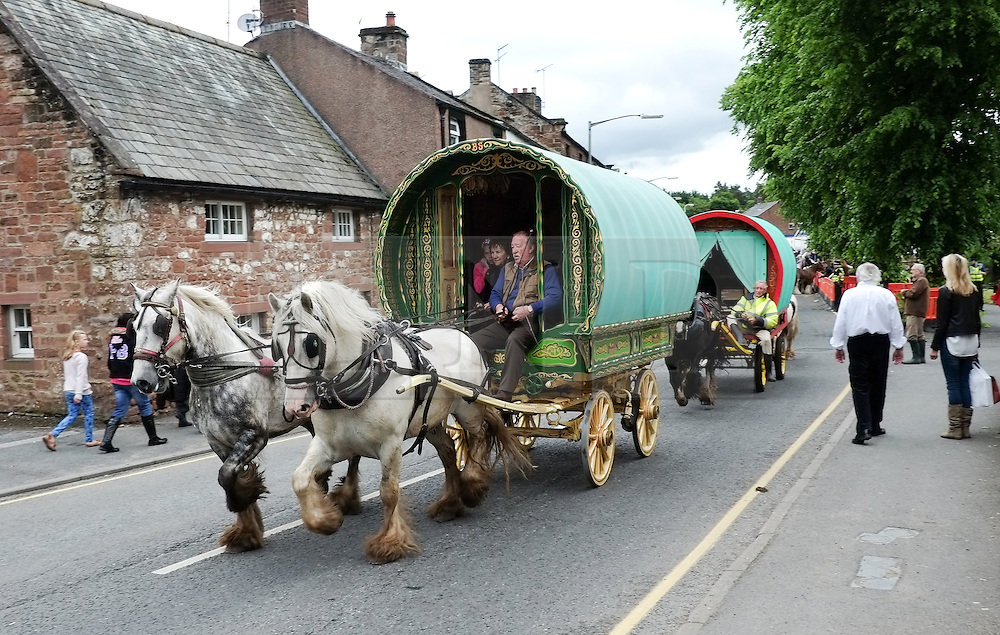 © Licensed to London News Pictures. <br /> 05/06/2014. <br /> <br /> Appleby, Cumbria, England<br /> <br /> A bow top wagon is driven to the campsite as gypsies and travellers gather during the annual horse fair on 5 June, 2014 in Appleby, Cumbria. The event remains one of the largest and oldest events in Europe and gives the opportunity for travelling communities to meet friends, celebrate their music, folklore and to buy and sell horses.<br /> <br /> The event has existed under the protection of a charter granted by King James II in 1685 and it remains the most important event in the gypsy and traveller calendar.<br /> <br /> Photo credit : Ian Forsyth/LNP